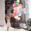 Woman with balloons — Stock Photo #13405667