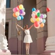 Stock Photo: Womwith balloons