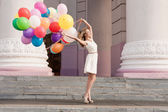 woman with balloons — Stok fotoğraf
