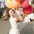 Woman with balloons — Stock Photo #13475255