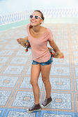 Woman with skateboard — Stock Photo