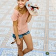 Woman with skateboard — Stock Photo #13516694