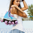 Stock Photo: Womwith roller skates