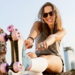 Woman with roller skates — Stockfoto