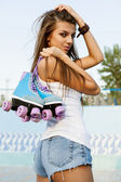 Woman with roller skates — Photo