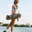 Woman with skateboard — Stock Photo #13785604