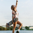 Woman with skateboard — Stock Photo #13785608