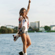Woman with skateboard — Stock Photo #13785609