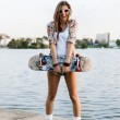 Woman with skateboard — Stock Photo #13785610