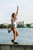 Woman with skateboard — Stok fotoğraf