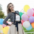 Woman with balloons — Stock Photo #13903882