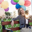 Woman with balloons — Stock Photo #13903883