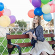Woman with balloons — Stock Photo #13903887