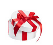 White gift box with red ribbon — Stockfoto