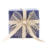 Blue gift box with gold ribbon — Stock Photo