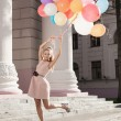 Woman with colorful balloons — Stock Photo #20621221