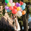 Woman with colorful balloons — Stock Photo #20621395