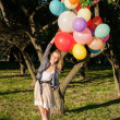 Woman with colorful balloons — Stock Photo #20621411