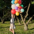 Woman with colorful balloons — Stock Photo #20621465