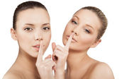 Women making a hush gesture — Stock Photo