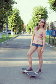 Woman with skateboard — ストック写真