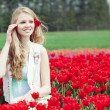 Beauty young woman with flowers tulips — Stok fotoğraf