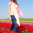 Woman in red tulip field — Stok fotoğraf