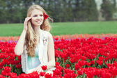 Beauty young woman with flowers tulips — Stock Photo