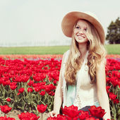 Woman in red tulip field — Stock Photo