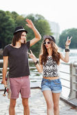 Yong couple on the bank of a river — Stock Photo
