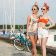 Sexy women on a pier — Stock Photo