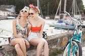 Sexy women on a pier — Stock Photo