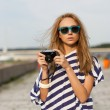 Young woman taking a picture — Stock Photo #26938679