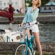 Sensual girl with bicycle — Stock Photo