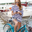 Sensual woman with bicycle — Lizenzfreies Foto