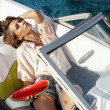 Attractive young girl on a yacht — Stock Photo #28598035