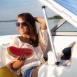 Attractive young girl on a yacht — Stock Photo