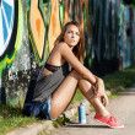 Girl near wall with graffiti — Stock Photo #28598059