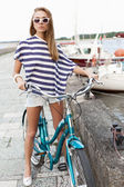 Sensual woman with bicycle — Stock Photo