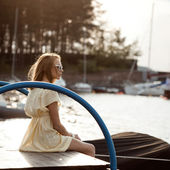 Pretty girl on the sea background — Stock Photo