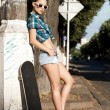 Girl with a skateboard — Stock Photo