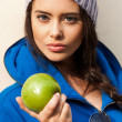 Happy Young Woman Eating Apple — Stock Photo