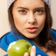 Happy Young Woman Eating Apple — Stock Photo #32477161