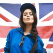 Beautiful young brunette woman with british flag — Stock Photo