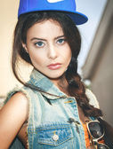 Closeup of Young sexy woman in blue cap — Stock Photo