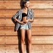 Sexy young woman wearing shorts — Stock Photo #34011257