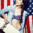 Woman in sunglasses with national usa flag — Foto Stock