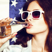 Woman in sunglasses with national usa flag — Stock Photo