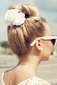 Beautiful girl with bow coiffure — Stock Photo