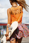 Girl with skateboard — Stock Photo
